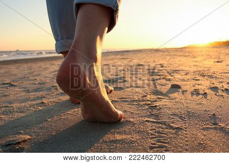 Taking a peaceful walk along the beach at sunset