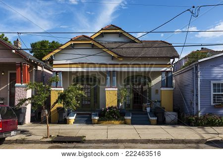 The facade of a traditional colorful house in the Marigny neighborhood in the city of New Orleans, Louisiana, USA