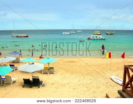 Tobago, Caribbean, West Indies - June 9, 2013 : Tourists enjoying the beach in Tobago an island in the West Indies