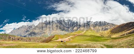 Gergeti Trinity Church Or Tsminda Sameba - Holy Trinity Church Near Village Of Gergeti In Georgia. Church Is Situated At An Elevation Of 2170 Meters, Under Mount Kazbegi. Panorama At Spring Season.