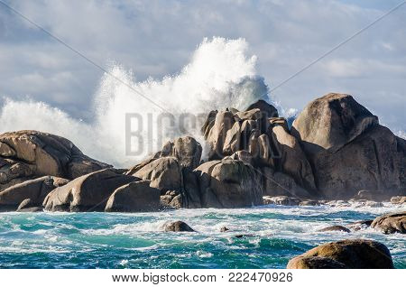 Impressive waves crashing on rocks coastline at San vicente de Grove, Galicia, Spain. Sunny day