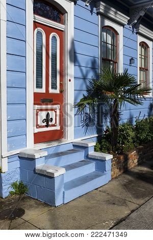 Detail of the door and facade of a colorful house in the Marigny neighborhood in the city of New Orleans, Louisiana, USA