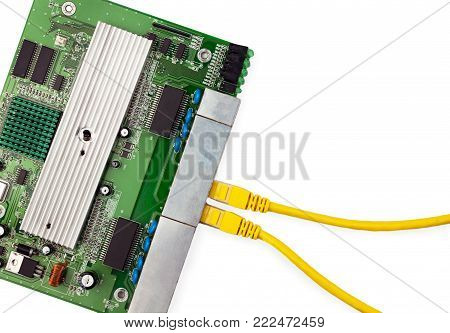 Ethernet switch board with two yellow patch cords top view. There are place for text in the right.