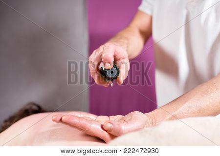 Anti-cellulite massage of the abdomen. Man hands massaging female.Therapist applying pressure on belly. osteopath doing manipulative massage on female abdomen.