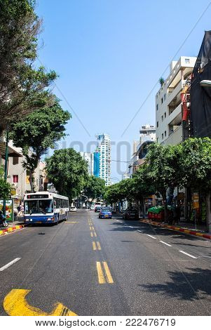 TEL AVIV, ISRAEL - AUGUST 18, 2010: Vertical picture of Ben Yehuda street with bus and cars in a sunny day in Tel Aviv, Israel