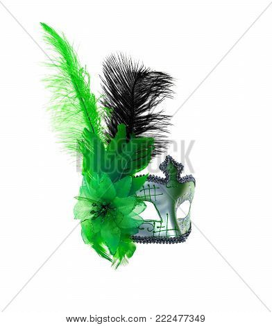 Green venetian carnival mask with feathers isolated on a white background.