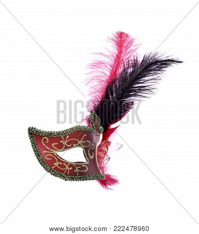 Red venetian carnival mask with feathers isolated on a white background.