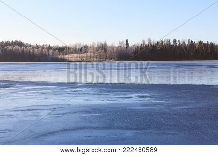 Cold morning winter lake scape in Finland
