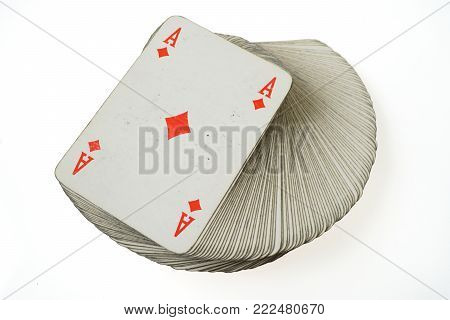 Stacked pile of old cards withAce of Diamonds at the top. Standard  French deck of 52 playing cards. Isolated on white background.