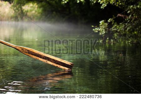 Wooden Paddle Over Misty Water