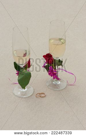 Photos with the symbolic image of two glasses of wine and two gold wedding rings