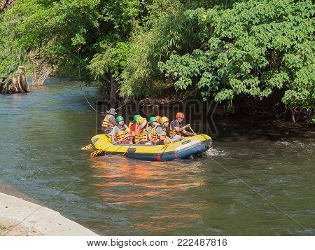 Nakhon Nayok , Thailand - January 13, 2018: Tourists paddle whitewater river in    Garden Uncle's , Capital District , Nakhon Nayok , Thailand.