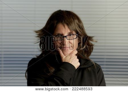 Pretty Woman With Brown Layered Hair Wearing Eyeglasses