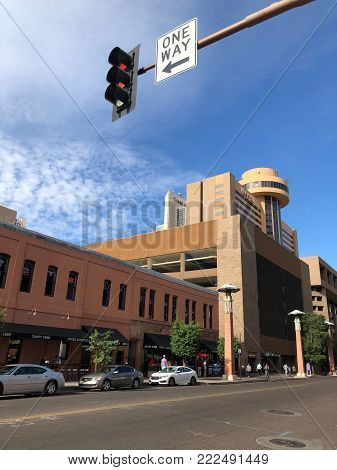 PHOENIX, AZ - DECEMBER 11, 2017: Traffic lights and One Way sign at 2rd St and Washington in Phoenix downtown, Arizona