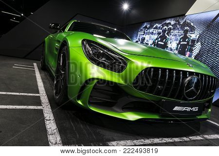 Sankt-Petersburg, Russia, January 12, 2018 : Green Mercedes-Benz AMG GTR 2018 V8 Bi-turbo exterior details, Headlight. Front view. Car exterior details