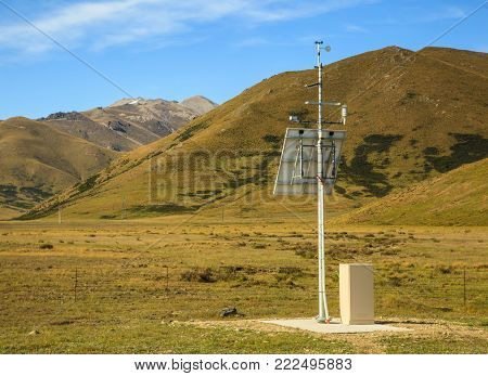 Solar Power Panel supplies energy to monitoring system in remote area.