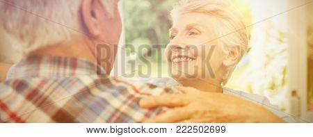 Cheerful senior couple dancing at home