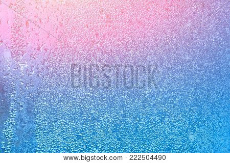 Natural background with condensation on the windows, high humidity. Textures of water droplets of rain flow down the glass