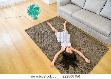 High Angle View Photo Of Girl Lying Down On Carpet