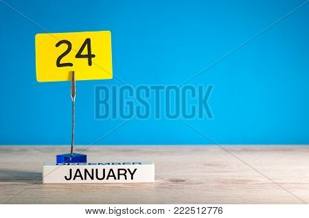 January 24th. Day 24 of january month, calendar on blue background. Winter time. Empty space for text, mock up.