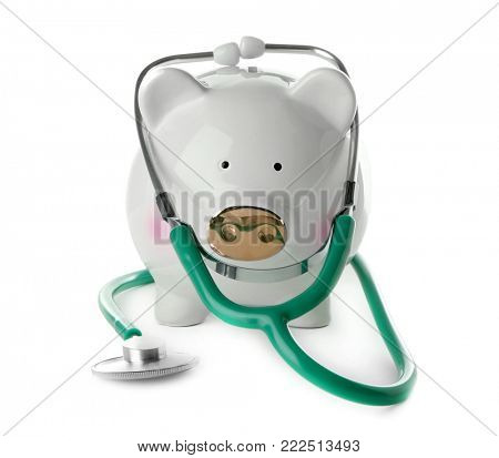 Piggy bank with stethoscope on white background. Health care concept