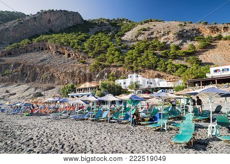 AGIA ROUMELI, CRETE - SEPTEMBER 23: Small beach with loungers and umbrellas at Samaria gorge national park on September 23, 2017 in Agia Roumeli