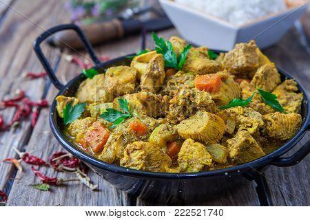 Chicken curry biryani indian style food with veggies