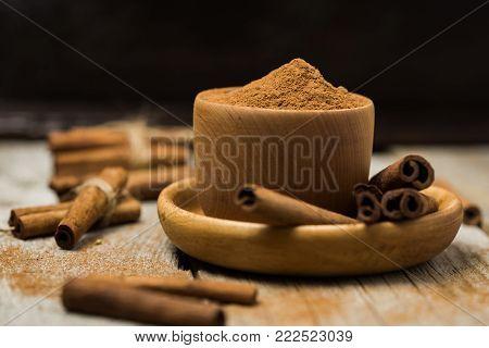 Ground Cinnamon Cinnamon Sticks Tied With Jute Rope And Cinnamon Powder In Rustic Style.