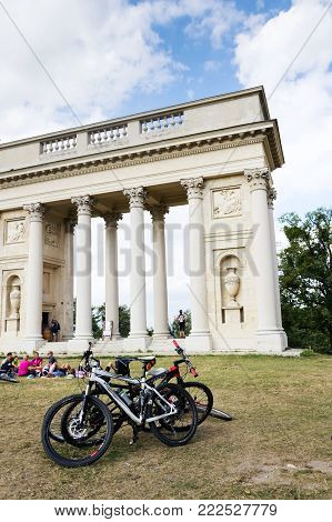 Valtice, Czech Republic - August 8: People With Bikes In Front Of Colonnade Reistna Classicist Glori