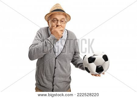 Mature man with a deflated football holding his hand over his mouth and laughing isolated on white background