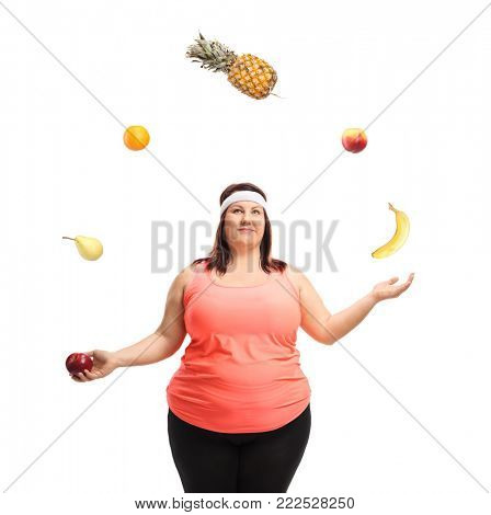 Overweight woman juggling with fruit isolated on white background