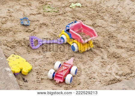 Children wooden sand box with some plastic toys