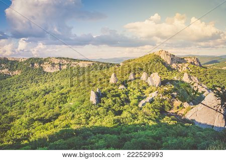 Temple of the Sun - a place of power on the southern coast of Crimea. View from the top of the mountain Ilyas Kaya. Summer sunny day. Enjoyable trip. Golden hour.
