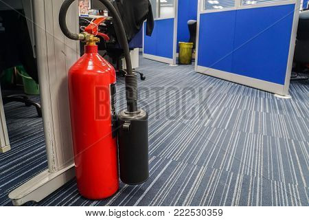 red fire extinguisher in office for safety