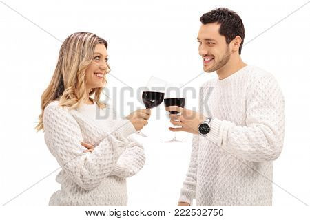 Young couple making a toast with wine isolated on white background