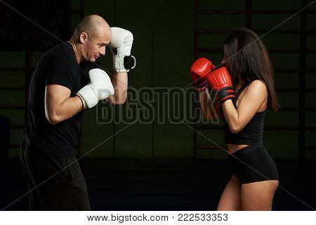 Boxing personal defense training. Young woman and man practice self defense