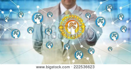 Unrecognizable man selecting one machine intelligence icon in network. Concept for deep structured learning, artificial intelligence, machine learning, AI, MI, nonlinear processing and deep network.