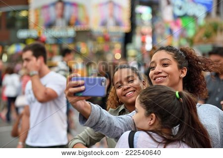 NEW YORK CITY - AUG. 29: Unidentified people on the Times Square in Manhattan on August 29, 2017 in New York City, NY. Times Square is a major tourist destination and entertainment center.