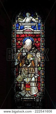 ROME, ITALY - SEPTEMBER 02: Saint John Chrysostom on the stained glass of All Saints' Anglican Church, Rome, Italy on September 02, 2016.