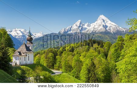 Idyllic mountain scenery in the Alps with pilgrimage church of Maria Gern and famous Watzmann summit in the background on a sunny day with blue sky in summer, Berchtesgadener Land, Bavaria, Germany