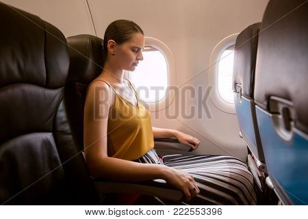 Woman in plane suffer from airsick with stress headache