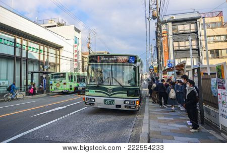 Kyoto, Japan - Nov 29, 2016. A bus stopping at station in Kyoto, Japan. The Kyoto City Buses are major mean of public transport in Kyoto.