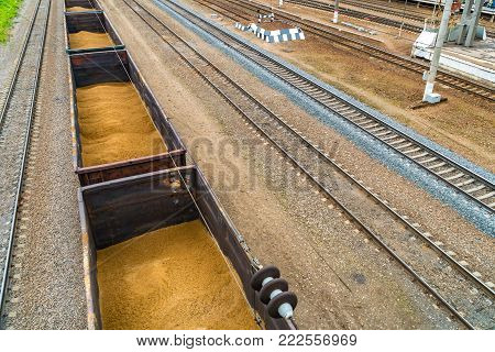 Railway wagons loaded with sand. Wagons filled with sand are on the spare rail journey.