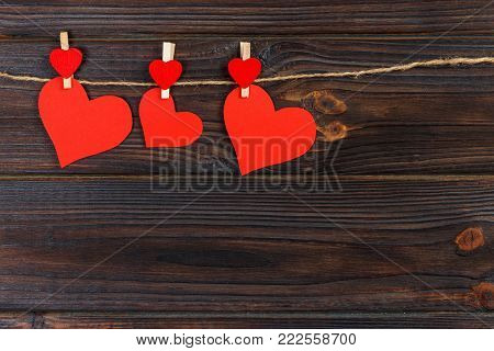 Love paper heart on string. Valentine day concept, copy space.