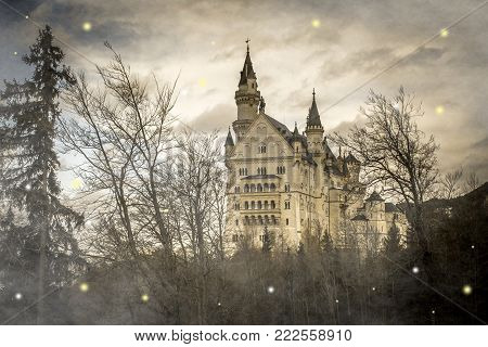 Fantasy view of fairy Neuschwanstein castle in the mystique forest, Bavaria, Germany