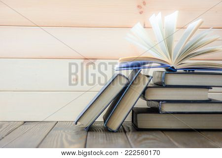 Book Stacking. Open Book, Hardback Books On White Background. Back To School. Copy Space For Text