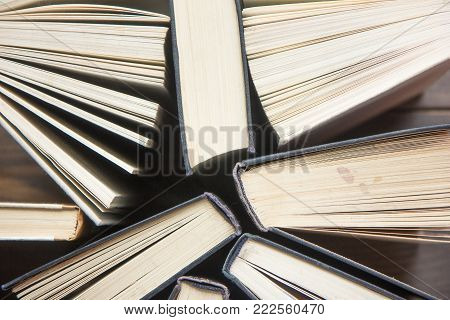Stack of colorful books. Education background. Back to school. Book, hardback colorful books on table. Education