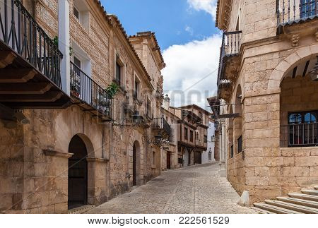 Typical narrow street with cobblestone stairs and colorful houses in old town. Toledo, Castilla La Mancha, Spain, Western Europe.