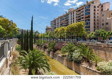 Palma de Mallorca, houses on the background of a road and trees. Palma de Mallorca, at home.