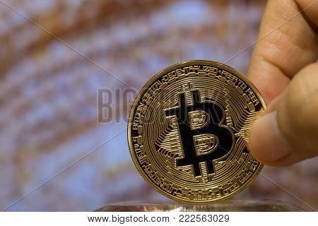 Hands holding Bitcoin Digital Virtual money.Bitcoin is Digital currency modern of Exchange Virtual payment money, Gold Bitcoins circuit with B letter on Blur light background. Finance investment risk